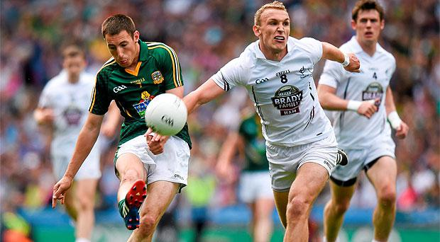Damien Carroll in action against Kildare's Tommy Moolick