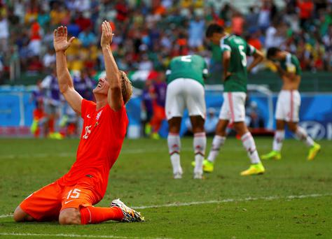Dirk Kuyt of the Netherlands celebrates after team mate Wesley Sneijder scored a goal during their 2014 World Cup round of 16 game against Mexico