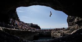 Andy Jones, USA, dives from the 28 metre platform during the seeding round of the third stop of the Red Bull Cliff Diving World Series, Inis Mor, Aran Islands, Co. Galway. Picture credit: Samo Vidic / SPORTSFILE