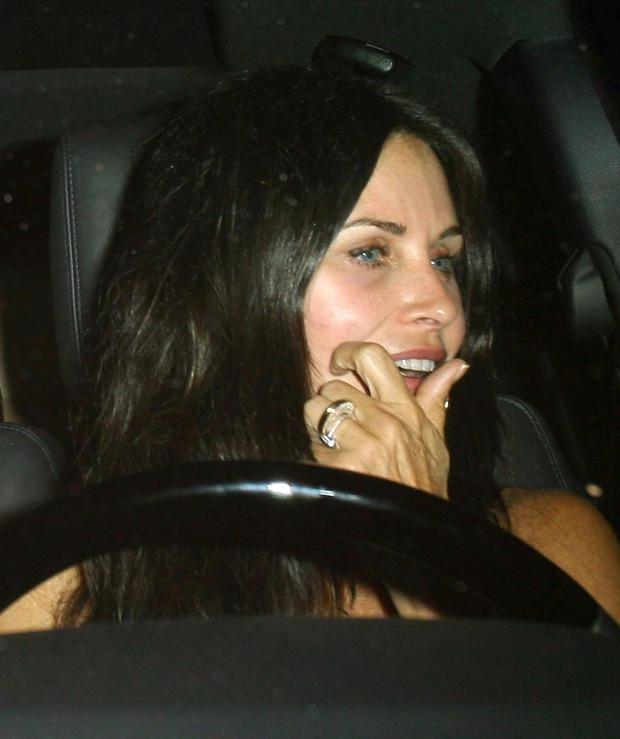 Courteney Cox flashes her engagement ring. Picture: Fame Flynet