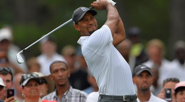 Tiger Woods hit his tee shot on the second hole during the second round of the Quicken Loans National golf tournament at Congressional Country Club