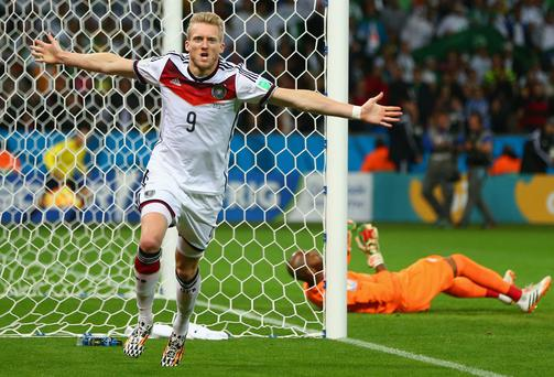 PORTO ALEGRE, BRAZIL - JUNE 30: Andre Schuerrle of Germany celebrates scoring his team's first goal past goalkeeper Rais M'Bolhi of Algeria during the 2014 FIFA World Cup Brazil Round of 16 match between Germany and Algeria at Estadio Beira-Rio on June 30, 2014 in Porto Alegre, Brazil. (Photo by Jamie Squire/Getty Images)