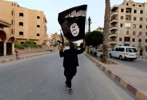 "A member loyal to the Islamic State in Iraq and the Levant (ISIL) waves an ISIL flag in Raqqa. The offshoot of al Qaeda which has captured swathes of territory in Iraq and Syria has declared itself an Islamic ""Caliphate"" and called on factions worldwide to pledge their allegiance, a statement posted on jihadist websites said on Sunday. The group, previously known as the Islamic State in Iraq and the Levant (ISIL), also known as ISIS, has renamed itself ""Islamic State"" and proclaimed its leader Abu Bakr al-Baghadi as ""Caliph"" - the head of the state, the statement said. REUTERS/Stringer"