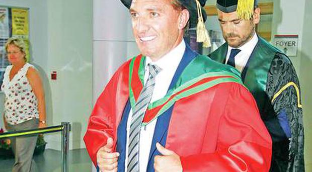 Liverpool boss Brendan Rodgers steps forward to receive his honorary degree