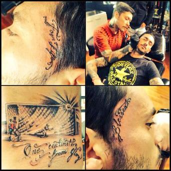 Mauricio Pinilla getting his tattoo done