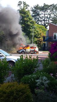 A car believed to be involved with the incident on fire
