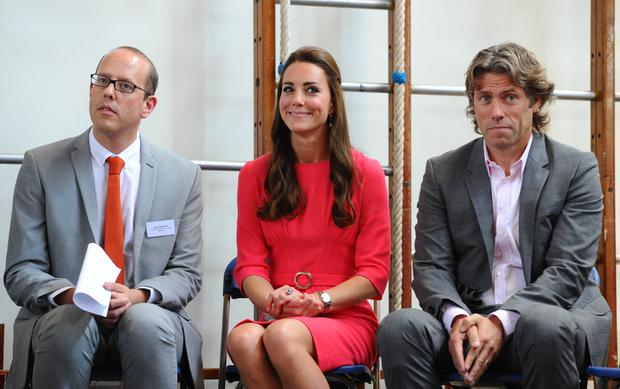 LONDON, ENGLAND - JULY 01: Catherine, Duchess of Cambridge and John Bishop visit an M-PACT Plus Counselling programme at Blessed Sacrament School on July 1, 2014 in London, England. (Photo by Stuart C. Wilson - WPA Pool /Getty Images)