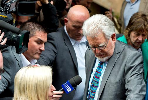 Artist and television personality Rolf Harris leaves court after being found guilty of 12 indecent assault charges at Southwark Crown Court after a seven week trial in London, England. 84-year-old Rolf Harris who has been found guilty of indecently assaulting four girls between 1968 and 1986, was arrested in March 2013 by police officers working for Operation Yewtree. (Photo by Ben A. Pruchnie/Getty Images)