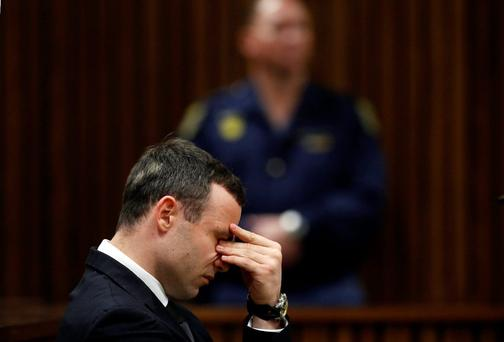 South African Olympic and Paralympic sprinter Oscar Pistorius sits in the dock during his trial in the North Gauteng High Court in Pretoria. Pistorius is on trial for murdering his girlfriend Reeva Steenkamp at his suburban Pretoria home on Valentine's Day last year. REUTERS/Mike Hutchings