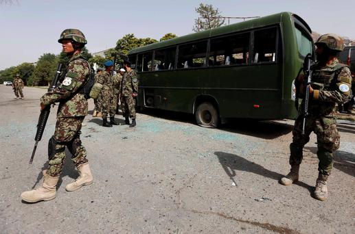 Afghan National Army soldiers (ANA) stand guard at the site of a suicide attack in Kabul
