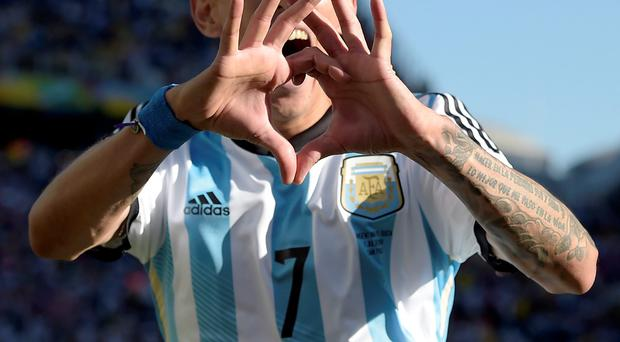 Argentina's Angel di Maria celebrates after scoring his side's only and winning goal in extra time during the World Cup round of 16 soccer match between Argentina and Switzerland at the Itaquerao Stadium in Sao Paulo