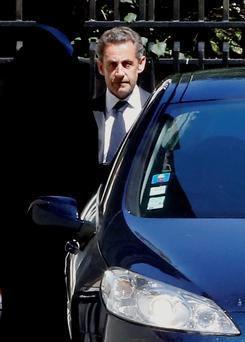 Sarkozy, his lawyer and a magistrate are facing preliminary charges in a corruption investigation linked to allegations that he took €50 million in illegal campaign funds from Libya's Moammar Gadhafi, after a night of questioning by judicial officials. (AP Photo/Jacques Brinon)