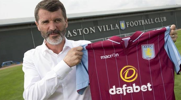 Roy Keane poses with an Aston Villa jersey
