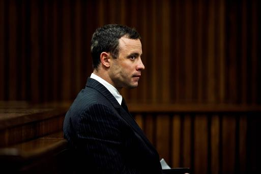 South African Olympic and Paralympic sprinter Oscar Pistorius sits in the dock during his trial in the North Gauteng High Court in Pretoria. Reuters