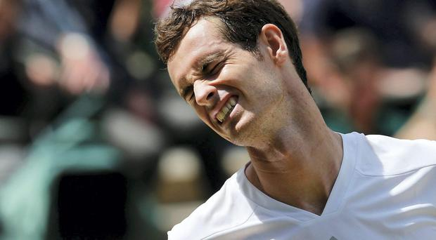Andy Murray shows the strain during his quarter-final defeat to Grigor Dimitrov at Wimbeldon. Photo credit: REUTERS/Suzanne Plunkett