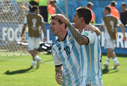 Argentina's forward and captain Lionel Messi and Argentina's midfielder Angel Di Maria celebrate after scoring the 1-0 during of a Round of 16 football match between Argentina and Switzerland at Corinthians Arena in Sao Paulo during the 2014 FIFA World Cup. AFP PHOTO / NELSON ALMEIDA