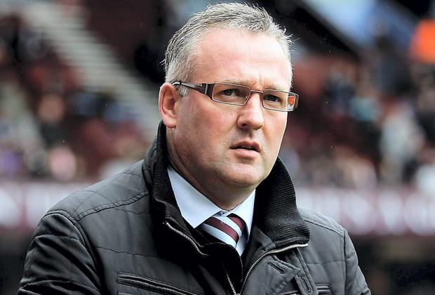 BIRMINGHAM, ENGLAND - APRIL 05: Aston Villa manager Paul Lambert looks on prior to the Barclays Premier League match between Aston Villa and Fulham at Villa Park on April 5, 2014 in Birmingham, England. (Photo by Ben Hoskins/Getty Images)
