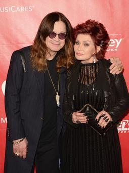 LOS ANGELES, CA - JANUARY 24: Singer Ozzy Osbourne (L) and TV personality Sharon Osbourne attend The 2014 MusiCares Person Of The Year Gala Honoring Carole King at Los Angeles Convention Center on January 24, 2014 in Los Angeles, California. (Photo by Jason Merritt/Getty Images)