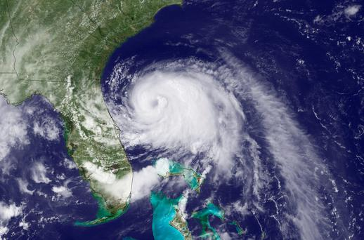 The first named storm of the Atlantic hurricane season has strengthened to a hurricane, and threatened to give North Carolina a glancing blow on Independence Day, prompting the governor to warn vacationers along the coast not to risk their safety by trying to salvage their picnics and barbecues. (AP Photo/NOAA)