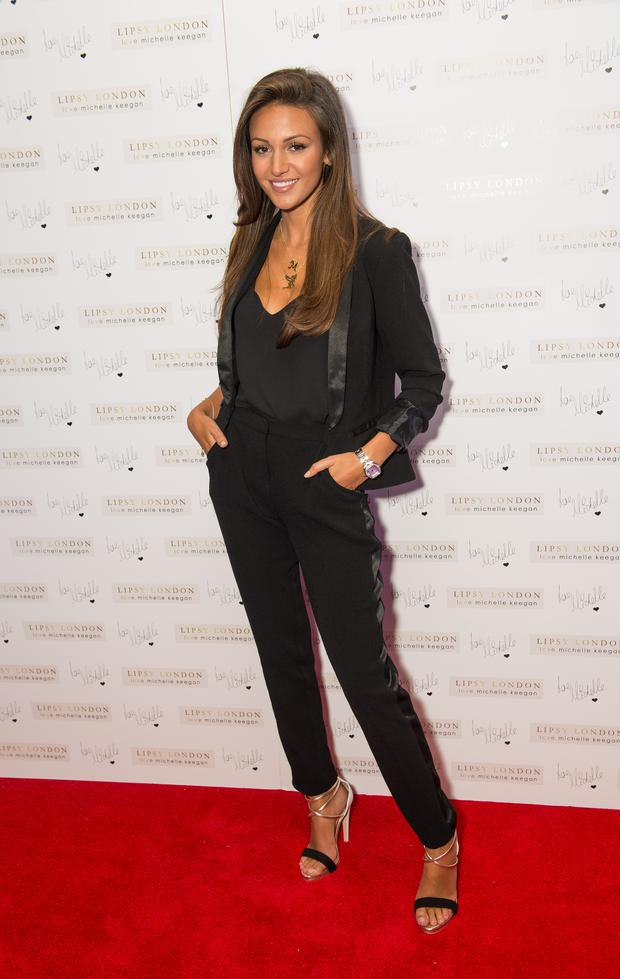 LONDON, ENGLAND - JULY 02: Michelle Keegan attends a photocall to launch the Lipsy London Loves Michelle collection at Rosewood London on July 2, 2014 in London, England. (Photo by Samir Hussein/Getty Images)