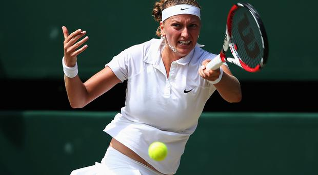 Petra Kvitova plays a forehand return during her Ladies' Singles semi-final match against Lucie Safarova on day 10 of the Wimbledon Lawn Tennis Championships