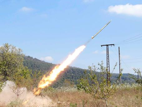Rebel fighters fire a Grad rocket towards forces loyal to Syria's President Bashar al-Assad in the countryside of the coastal city of Latakia. Photo credit: REUTERS/Alaa Khweled