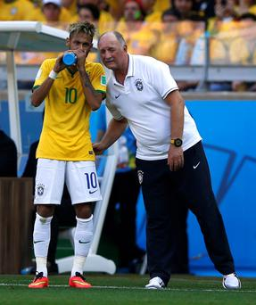 Brazil's coach Luiz Felipe Scolari talks with Neymar