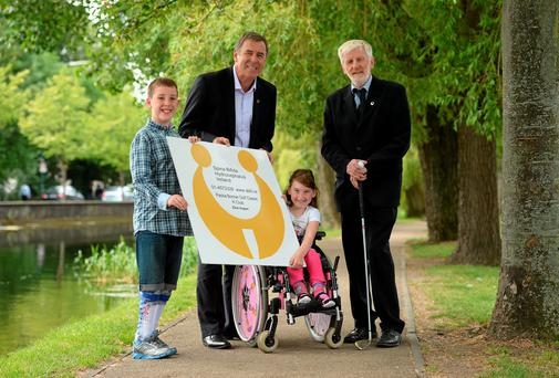 Packie Bonner with director of Spina Bifida Hydrocephalus Ireland Fiach McDonagh, nine-year-old Matt Dooley from Blanchardstown, and seven-year-old Sophie Biggins from Swords at the launch of the Packie Bonner 2014 Golf Classic. Photo: Matt Browne / SPORTSFILE