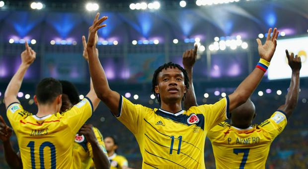 Colombia midfielder Juan Cuadrado says the key to his side's starring role at the World Cup so far is that 'we do not compromise'. Photo: Clive Rose/Getty Images