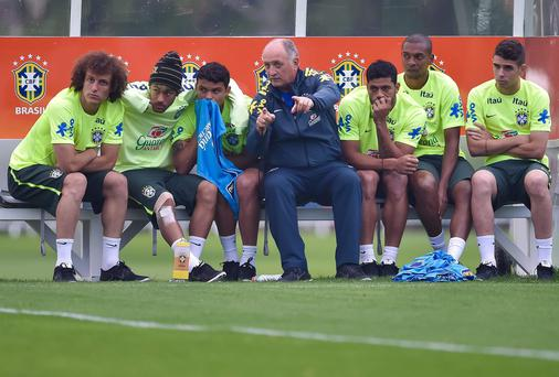David Luiz, Neymar and Thiago Silva, Hulk, Fernandinho and Oscar listen to instructions from Brazil coach Luiz Felipe Scolari at training ahead of their quarter-final against Colombia. Photo: Buda Mendes/Getty Images