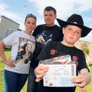 03/07/2014 News 10 year old Cameron Cloke from Enniscorthy, Co.Wexford hoping that the Garth Brooks concert on Sunday isn't cancelled. Cameron is photographed with his parents Donna Marie and Michael. Photo; Mary Browne