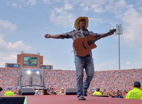NORMAN, OK - JULY 06: Garth Brooks performs during the Oklahoma Twister Relief Concert to benefit United Way of Central Oklahoma May Tornadoes Relief Fund at Gaylord Family Oklahoma Memorial Stadium on July 6, 2013 in Norman, Oklahoma. To donate go to www.unitedwayokc.org or text REBUILD to 52000. (Photo by Rick Diamond/Getty Images for Shock Ink)