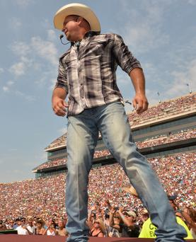 Garth Brooks performs during the Oklahoma Twister Relief Concert to benefit United Way of Central Oklahoma May Tornadoes Relief Fund at Gaylord Family Oklahoma Memorial Stadium on July 6, 2013 in Norman, Oklahoma. (Photo by Rick Diamond/Getty Images for Shock Ink)