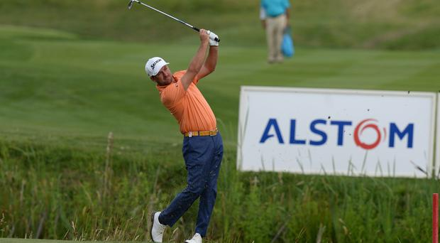 Graeme McDowell of Northern Ireland plays his second shot on the 10th fairway during the Alstom Open de France - Day Two at Le Golf National