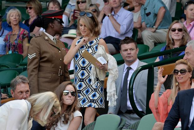 Brian O'Driscoll and his wife Amy Huberman arrive in the Royal Box during day twelve of the Wimbledon Championships
