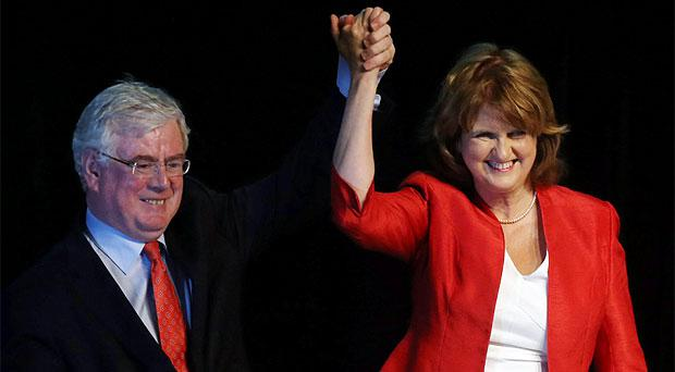 New leader of the Labour Party Joan Burton is congratulated by her predecessor Eamon Gilmore