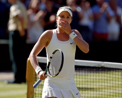 Canada's Eugenie Bouchard reacts after beating Romania's Simona Halep in the Wimbledon semi-final