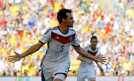 Germany's Mats Hummels celebrates after scoring a goal against France during the 2014 World Cup quarter-final at the Maracana stadium in Rio de Janeiro