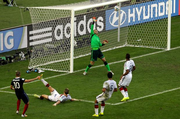 Germany's goalkeeper Manuel Neuer makes a crucial save France's Karim Benzema in the very last minute of the World Cup quarter-final