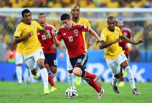 Colombia's James Rodriguez paces away from of Brazil midfield pair Paulinho and Fernandinho during the World Cup quarter-final in Fortaleza. Photo: Laurence Griffiths/Getty Images