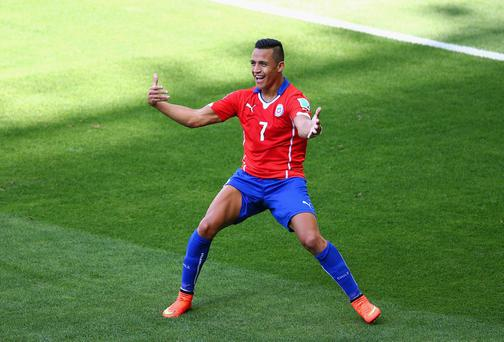 Alexis Sanchez - one of the stars of the World Cup - is coveted by both Liverpool and Arsenal, and is seen by the Anfield club as a key part of any deal with Barcelona for Luis Suarez. Photo: Ian Walton/Getty Images