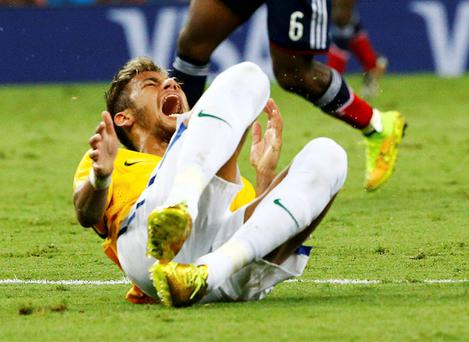 Brazil's Neymar grimaces after being fouled during the 2014 World Cup quarter-finals against Colombia at the Castelao arena in Fortaleza. Reuters