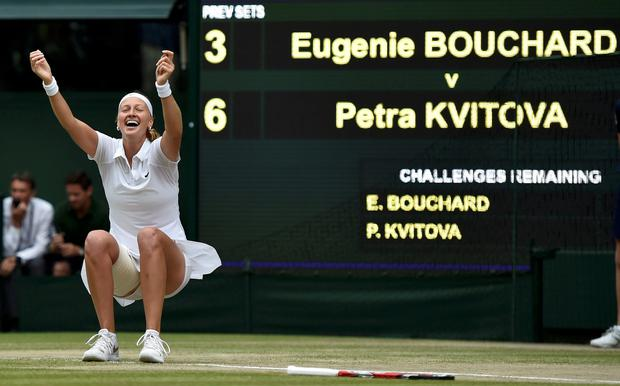 Petra Kvitova of the Czech Republic celebrates after defeating Eugenie Bouchard of Canada in the 2014 women's Wimbledon final