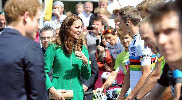 The Duchess of Cambridge talks to World Champion cyclist Rui Costa at the start of the 2014 Tour de France.