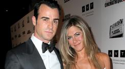 STAR: Jennifer Aniston with partner Justin Theroux, who plays a police chief in new TV drama 'The Leftovers'
