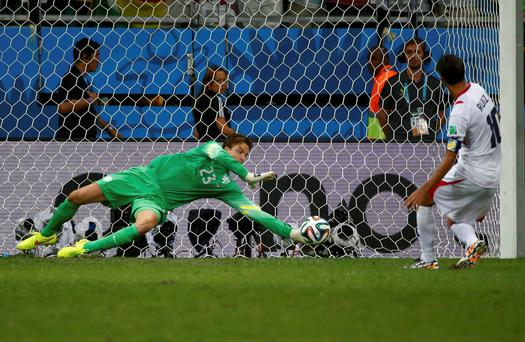 Tim Krul of the Netherlands saves the penalty kick of Bryan Ruiz of Costa Rica in a shootout during the 2014 FIFA World Cup Brazil quarter-final