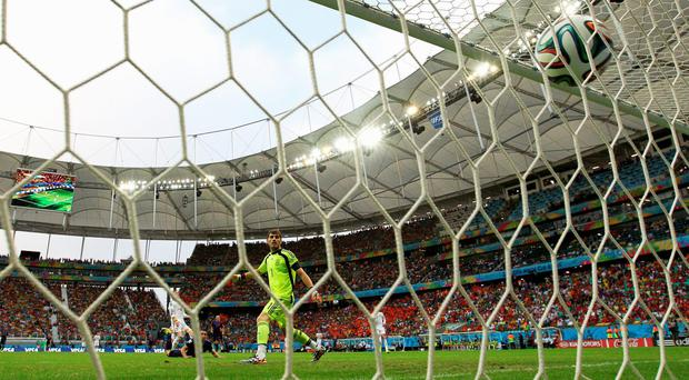 SALVADOR, BRAZIL - JUNE 13: Iker Casillas of Spain watches as a header from Robin van Persie of the Netherlands goes over his head for a goal in the first half during the 2014 FIFA World Cup Brazil Group B match between Spain and Netherlands at Arena Fonte Nova on June 13, 2014 in Salvador, Brazil. (Photo by Dean Mouhtaropoulos/Getty Images)