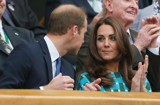 Britain's Prince Wililam and his wife Catherine, Duchess of Cambridge sit on Centre Court at the Wimbledon Tennis Championships, in London. Reuters/Stefan Wermuth