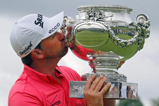 Graeme McDowell kisses the trophy after winning the French Open Golf tournament at Paris National course in Guyancourt