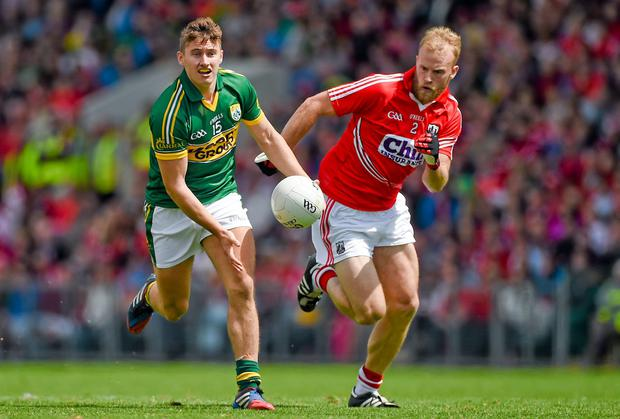 James O'Donoghue, Kerry, in action against Michael Shields, Cork